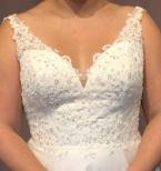 Glittrig tyllklänning med snörning