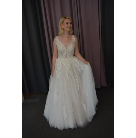 Fantastisk brudklänning med beige botten och vackra detaljer